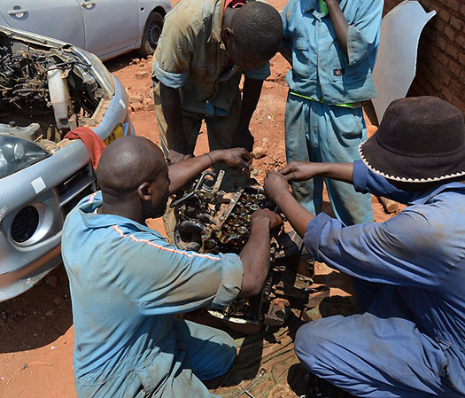 Students learning skills to become mechanics