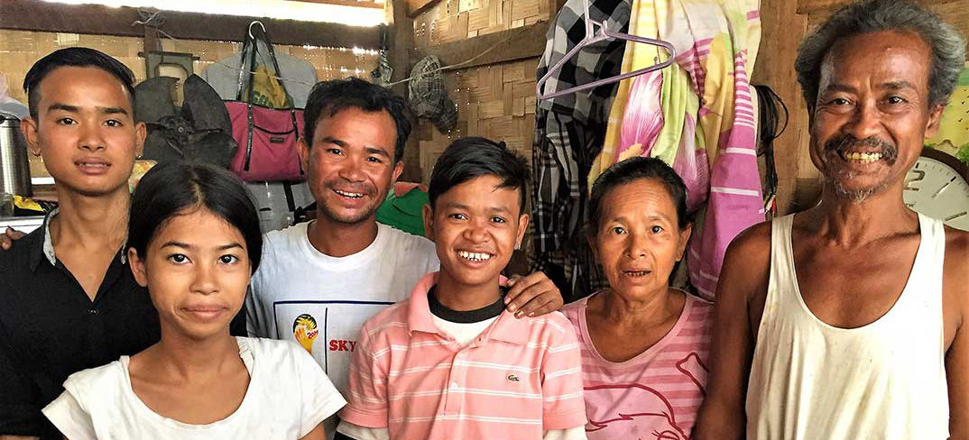 Family in Myanmar slum